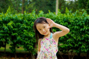 Outdoor portrait of little asian girl